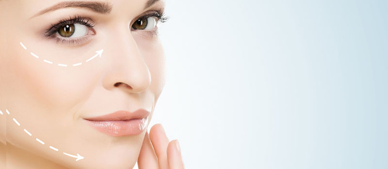 woman touching face collagen
